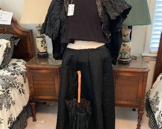 This  is a wedding going away outfit 1902 yr.-4 pieces.parasol,skirt, lace bodice and cape(black sweater not included   $100.