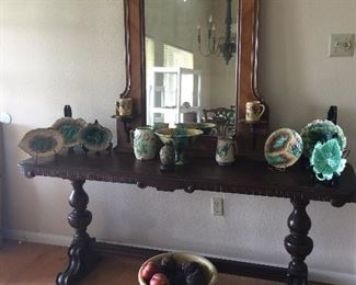 This is the antique, sofa table. The dimensions are listed in the sale's description. The Majolica plates will be in PART II of the sale because they have been taken offsite.