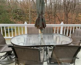 PATIO TABLE, 6 CHAIRS UMBRELLA AND STAND $575.00.  CAPTAIN CHIRS ARE SWIVEL.