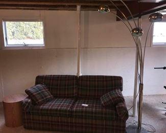 73 Inch Sleeper Sofa, Carpet, Table, and Lamp