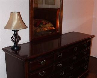 "2nd View: Dixie Cherry 10-Drawer Dresser 34.5""H x 66""W x 19.5""D) with Center Finial Broken Arch Beveled Mirror(47.5""H x 31.5""W)"