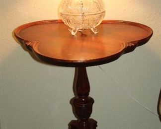 "Vintage Mahogany Clover Shape Pie Crust Edge Occasional Pedestal Tables on 3 Splayed Legs. 26.5""H x 21""D.   (1 of 2 shown) Also shown is a small Crystal Vanity Lamp"