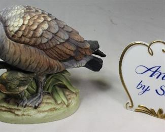 "Andrea by Sadek Canadian Goose w/ Duckling Figurine (5.75""H x 8""L x 4""D) Shown with a Porcelain ""Andrea by Sadek"" Sign"
