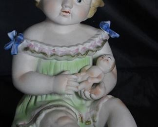 "Antique Porcelain Bisque Piano Baby with Doll.  Made in Germany  (12""H x 10,""D x 8""W)"