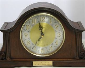 Bulova Chadbourne Tambour Mantel Clock Bent hardwood Mahogany finish Case. Raised numerals on metal dial w/ Glass Face . Battery Operated Triple chime Engraved plate