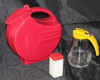 Depression Era Art Deco Red Plastic Pitcher Shown with Vintage Yellow Plastic Lid Glass Syrup Pitcher and Red and White Plastic Pepper Shaker