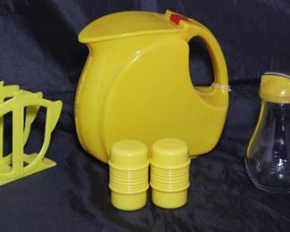 Depression Era Art Deco Yellow Plastic Pitcher Shown with Vintage Rogers Products Yellow Plastic Napkin Holder, ABCD Shakers and Yellow Plastic Lid Glass Syrup Pitcher