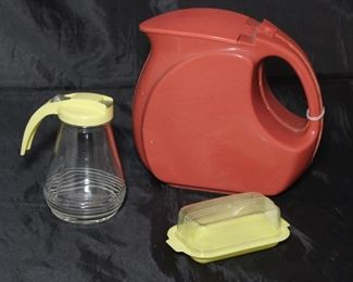 Wata-Kanta Depression Era Art Deco Terracotta Red Plastic Pitcher Shown with Vintage Yellow Plastic Lid Glass Syrup Pitcher and The Burroughs Co. Clear Plastic Lid Yellow Butter Tray