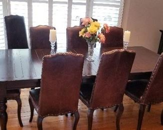 "$ 850 O.BO     BEAUTIFUL DINING TABLE WITH 2 EXTENSION LEAVES, TABLE PADS, AND 10 CHAIRS FROM POTTERY BARN.  DIMENSIONS TABLE 54"" X42 ""WITHOUT LEAVES   EACH LEAF IS 18"" X 42""  FOR A TOTAL OF 90 ""X 42 """