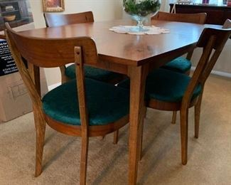 Mid Century Table & Chairs $600 **pic 1 (without leaves)**   Great shape, solid.  Table and chairs have small inlaid design.  Table has two leaves and comes with fabric table pad to go under table cloth.  78L 36W 29H with both leaves, 54L  without leaves.   Chairs have been recovered.