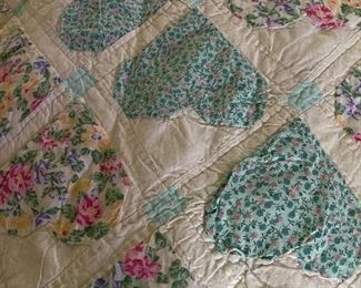 King size quilt with different color hearts including pink, purple etc .. very large and thick .. very nice quilt appears to be hand stitched  100.00