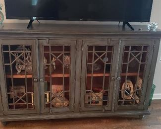 distressed modern cabinet / flat top/wooden inside shelves / wooden/glass doors  $425