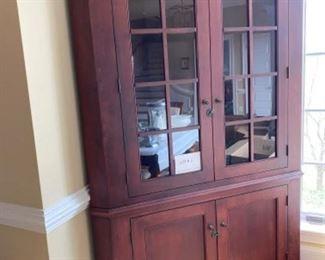 Maple Amish corner cabinet with cherry finish