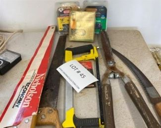 Lot of hand saws, 3 chainsaw chains, hedge trimmers.