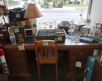 Large Vintage Desk-$250 Decanters-$10 Crystal Decanters-$40 Waterford Decanter-$125 Vintage Post Card Collection-$2 ea History of the US Books-$25 all Austin Stone Lamp-$45 Vintage Doctor Bag-$30   Vintage Briefcase-$20 Crown Royal Glasses-$8 pr Wild Turkey Glasses-$8 pr Vintage Decanter Pair-$25
