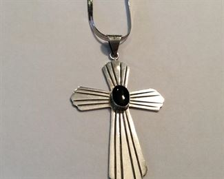 """Cross with onyx measures 3.5 in by 2 in, weighs 18.2 grams and is marked """"TS-134 Mexico 925."""" It is paired with a 30 inch herringbone chain marked """"Italy 925,"""" and weighs 10.5 grams. $75.00"""