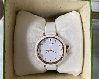 Lot 001 New with tags...Kate Spade watch with large white and gold face with rubber band $58 -