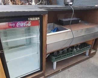 Lot 1    6 ft portable bar  $800.00  Photo #3                      Back side of the portable bar with built in ice well, sink and refrigerator.