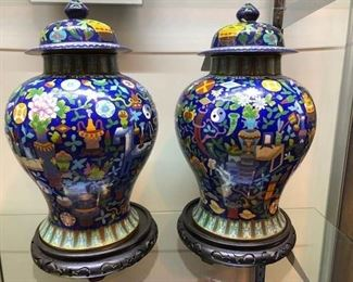 Matched signed pair of large cloisonne vases on stands. These are very colorful, and they are magnificent in person.