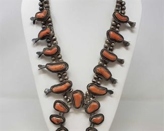 """917: FINE Vintage Navajo Sterling Silver Free Form Coral SQUASH BLOSSOM Necklace Value 1750.00-2000.00 24"""" Length 14 1/2"""" Drop From the Top of One End to the Bottom of Necklace Large Center Piece Naja Measures 3 1/2"""" X 3 1/2"""" Value 1750.00-2000.00 The Ten Blossoms Measure about 1 3/4"""" Length FINE Vintage Navajo Sterling Free Form Coral Squash Blossom Necklace. Beautiful High Quality Necklace with Great Patina Excellent Design and Craftsmanship Wearable / Collectible Native American ART WORK Unsigned Piece. Guaranteed Sterling Silver. Excellent Vintage Condition. 169 Grams"""