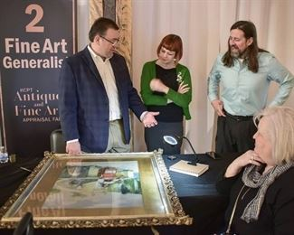 Jason Roske, Amy Abshier and Justin Rogers appraising a painting at the KCPT Antique and Appraisal Fair.