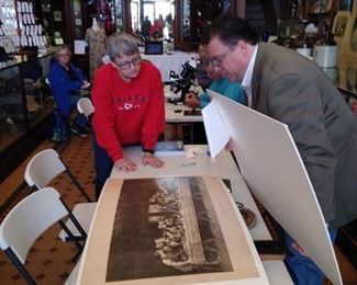 Jason appraising an engraving a the Clay County Historical Society Appraisal Event.