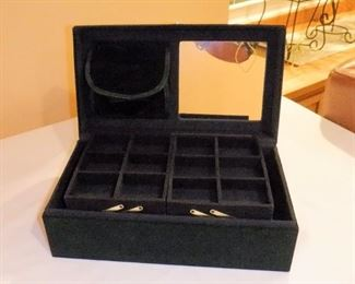"""Dark forest green velour covered jewelry box.  Mirror, pouch w/4 zippered sections, four raised trays (2 sectioned, 2 for rings), 4  sections in bottom.  Looks brand new.   12-1/8"""" wide, 6"""" tall.   $9 (was $12)"""