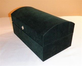 """Dark forest green velour covered jewelry box.  Mirror, pouch w/4 zippered sections, four raised trays (2 sectioned, 2 for rings), 4  sections in bottom.  Looks brand new.   12-1/8"""" wide, 6"""" tall.   $9 (was $12) $12"""