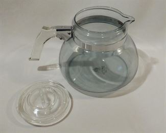 Rare, Pyrex Flameware tea kettle in super nice vintage condition.  Blue tinted glass with the green stamp (1930's) on the bottom.  No chips, cracks or rust on the metal parts.  Hold almost 3 quarts!   $40 (was $45)