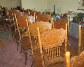 SET OF TWELVE Pressed back American Victorian style Kitchen chairs.  I would suggest that they are 40 years old. The family paid $99 PER chair, or around $1100 plus sales tax for the lot. $375 is the price!