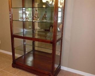 Howard Miller Display Cabinet,  Full Glass front slides each way. Price $600