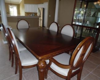 Price $550.  Broyhill Dining Set. Dining Table has 2 leaves (not shown). 2 Captain's/4 Side Chairs.