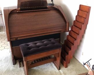 Lowrey Serenade Organ. Very good condition and on the main floor of a clean, smoke-free house near Ada. Includes bench and nice wood rack for music books.  $1,450.