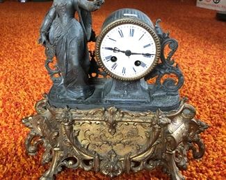 Antique mantle clock, figural, working condition unknown.  $110.