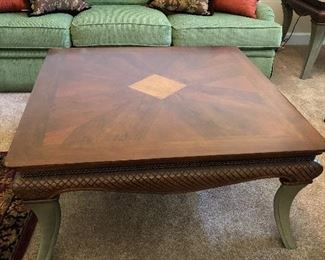 Gorgeous wood inlay coffee table/side table set with cast metal legs(perfect condition) $200.00 for the set.  Coffee table dimensions 40X40X19H