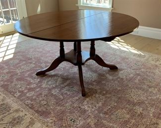 """Dining Table.   This is smaller round position.  60""""  round.   Rug is sold"""