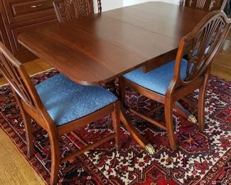 Duncan Phyfe drop-leaf dining table with 4 chairs.  $480