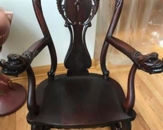 $ 1000 Up for sale is an antique mahogany Stickley  hand carved Dragon head rocking chair.  The rocking chair is in nice condition there was a break to one of the arms which was professionally repaired and he disassembled the rocking chair and re-glued all the joints.  This piece still contains the original Stickley and Brandt label underneath the seat as pictured.  The rocking chair measures 41 inches from the floor to the top of the back, the seat measures 19 inches deep, from front to back it measures 21 inches, across the middle of the seat the arms measure 17 inches long. As pictured this is a very nice piece we are firm on the price.