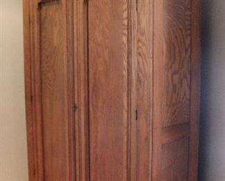 """Item 7   Eastlake style Armoire/Wardrobe.  C. 1890     82.5""""h x 43.75""""w x 15.5 dOak.  Interior has been altered for contemporary storage usage. $300.00"""