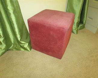 """Red upholstered ottoman. 16""""w X 16""""d X 16""""h PRICE: $25.00"""
