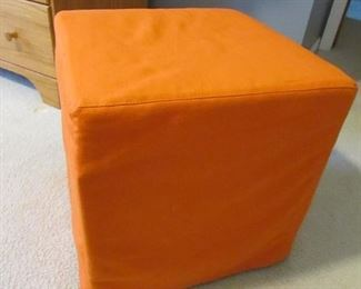 """15"""" square cube upholstered orange ottoman from Ikea. PRICE: $30.00"""