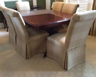 Mahogany Dining Room Table 43 inches wide by 67 inches long with  two 14 inch leaves by Universal Furniture LTD @ $750.00 and 8  yellow plaid chairs @125.00 each. Can be sold separately.