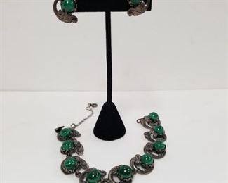 $425.00.                                                      Guglielmo Cini, Green Tigereye Bracelet & Clip-on Earrings