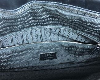 "Lot 7: Authentic PRADA leather bag; 14"" wide, 7"" tall; $245 (discounts not applicable)"