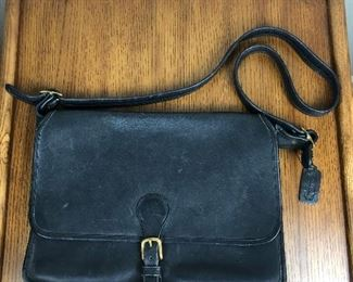 "Lot 8: Authentic COACH leather briefcase-style bag; 14"" wide, 10"" tall; $100 (discounts not applicable)"