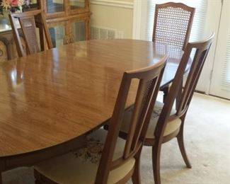 """Dining table and 6 chairs - $600 - 77"""" x 42"""" with extensions - 42"""" in diameter round when closed without extensions (there are 2 extensions)"""