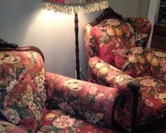 Two floral-print antique chairs with matching floor lamp
