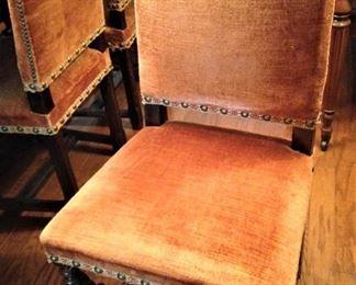 Nailhead detailing on each chair