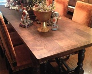 Antique table and orange upholstered chairs
