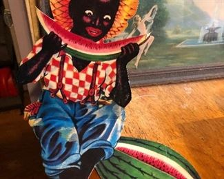 """- Vintage die cut cardboard black Americana display - folds in to a """"pop-up"""" sitting boy with fruit. (We have about 9 of these)"""